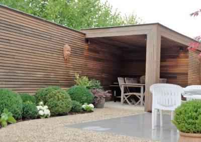 vanhauwood moderne tuinwand met berging padoek 5