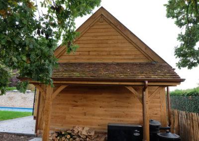 Vanhauwood - eiken poolhouse bourgondische tegelpannen en staalraam 4